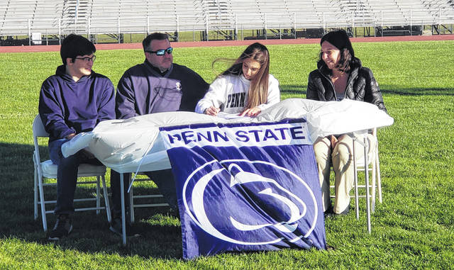 Allison Johnson signs to run cross country and compete in track and field at Penn State University. Pictured with the Mount Gilead senior are (l-r): brother Nathan and parents Joe and Jackie. Not available was Johnson's sister, Kaitlyn.