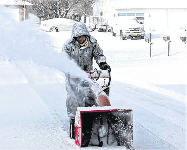 Mount Gilead resident Steve Hart clears a driveway for a neighbor.