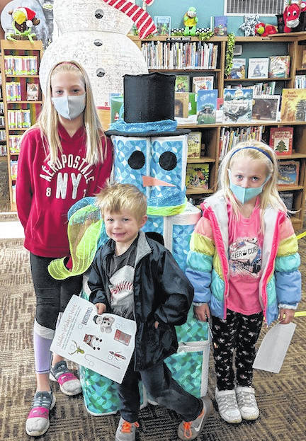Courtesy Photo Bailey, Bentley, and Millie Ulrey participate in the Hidden Holidays Hunt at Selover Library as part of the Selover Library Holiday Challenge.