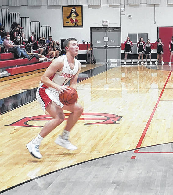 Cardington's Avery Harper gets ready to shoot a three-pointer in Tuesday night's win over visiting Highland.