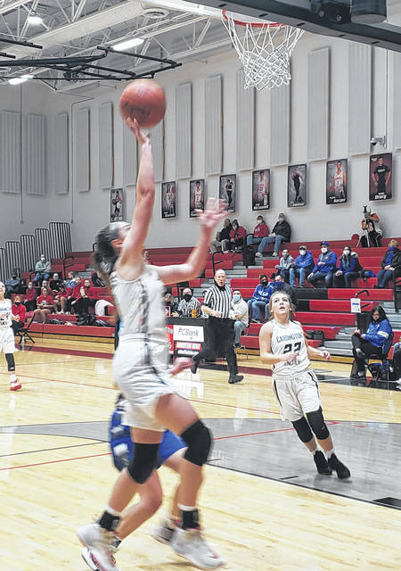 Cardington's Beth Hardwick drives for two of her game-high 19 points in her team's home win over league rival Danville Monday night.