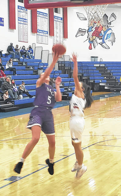 Holly Gompf works to score two of her 18 points in Mount Gilead's Wednesday night win at Highland.