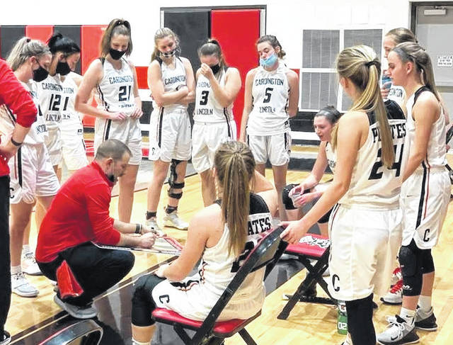 Cardington head coach Jamie Edwards gives his team instructions prior to the fourth quarter Tuesday night. The Pirates won 55-37 over Johnstown-Monroe in a Division III district semi-final game.