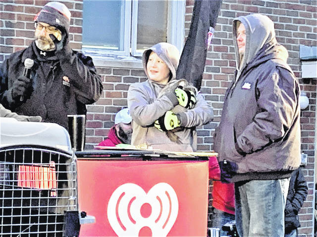 Paul James, left, of WMRN-AM in Marion announces the forecast from Buckeye Chuck, Ohio's official weather-forecasting groundhog, during the 2020 Groundhog Day celebration. This year, Buckeye Chuck has predicted an early spring. Meanwhile, Punxsutawney Phil in Pennsylvania is calling for six more weeks of winter.