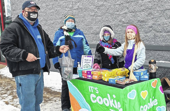 Girl Scout Cookies are available for purchase at the entrance of Auto Zone in Mount Gilead on Saturdays in February. Here Girl Scouts from Troop 3536 in the Highland School District make a sale of cookies. Girl Scouts and their leader Jackie Johnson of Troop 3536 braved 20-degree weather to sell cookies at the Auto Zone in Mount Gilead Saturday. The traditional cookies are available in popular Do-si-dos, Samoas, Trefoils and Thin Mints and Tag-alongs. Another troop is scheduled to be at Auto Zone this Saturday for cookie sales. Boxes are on sale at $5 per box again this year with a special drawing entry for a free case of cookies with the purchase of five boxes.