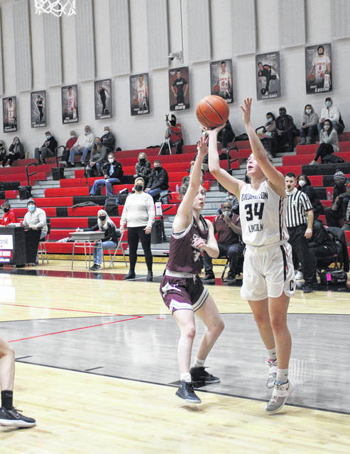 Emalee Artz puts up a shot for Cardington in their sectional tournament win over Columbus Academy on Saturday night.
