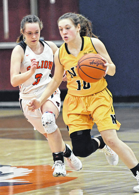 Northmor's Brooke Dennison (10) races up the floor under pressure from Galion's Dezi Lester during a non-conference girls basketball game played Thursday, Feb. 11, 2021, at Galion High School's gym. The Lady Knights prevailed 47-28 with Dennison scoring a game-high 15 points to lead the way.