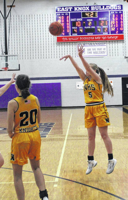 Northmor's Paige Caudill connected on three three-pointers in the second quarter to help propel her team past East Knox in Saturday's sectional basketball game.