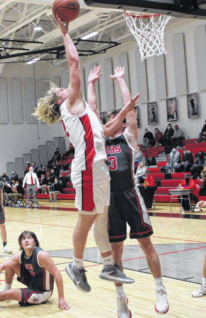 Cardington's Nate Hickman goes up for two points against Centerburg on Friday night.