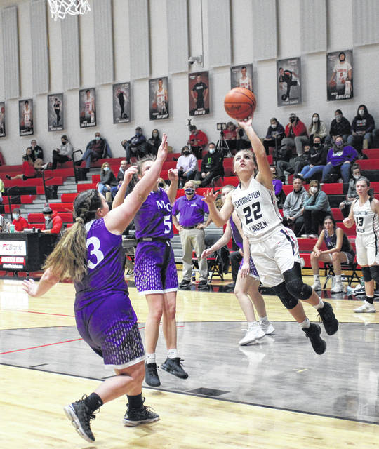 Cardington's Mikayla Linkous moves inside for a lay-up in her team's come-from-behind win over Mount Gilead on Saturday.