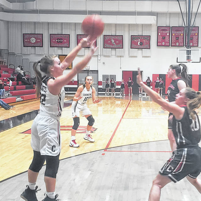 Mikayla Linkous puts up a shot in her team's win over Centerburg on Saturday. That win gave the Pirates their seventh straight league title and sixth straight outright championship after tying Elgin for first in the 2014-15 season.