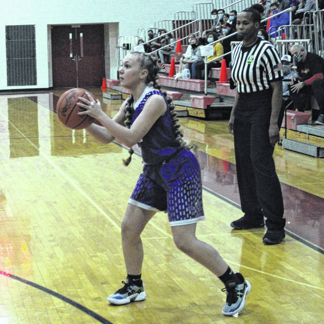Mount Gilead's Emarah Miller prepares to shoot in her team's district semifinal contest at Worthington Christian.