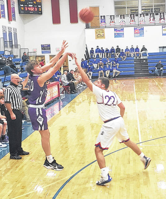 Paul Butterman looks to score from deep for Mount Gilead. His team put in 10 three-pointers in topping Highland Friday night.