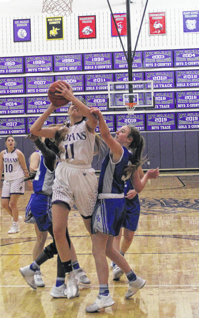 Isabella Schroeter works inside for a scoring attempt in Mount Gilead's 49-20 win over Bishop Ready Wednesday night.