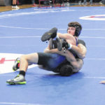 Highland wins five classes on way to claiming league wrestling title