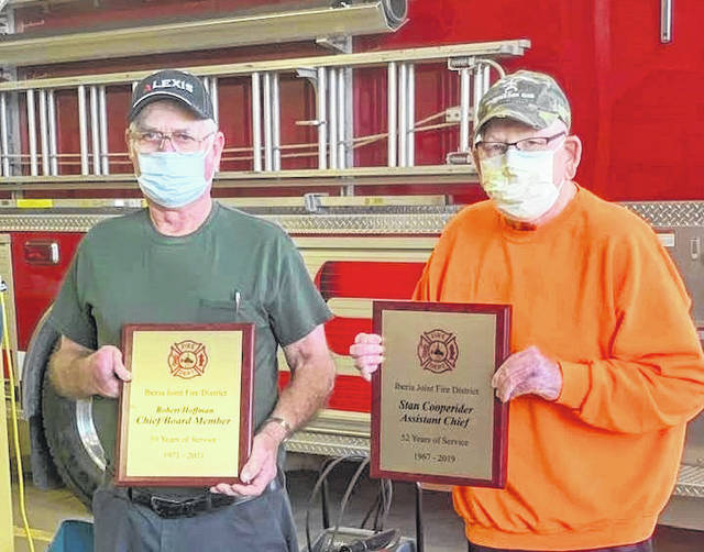 Bob Hoffman and Stan Cooperider were both honored for a half-century of service with the Iberia Volunteer Fire Company.