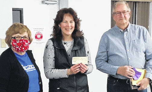 Rita Barton, president of the Chester Arbor of the Gleaners, presents a check in the amount of $500 to Dawn Ruehrmund and Pat Drouhard to help fund the restoration of the Civil War Monument in Glendale Cemetery, Cardington.