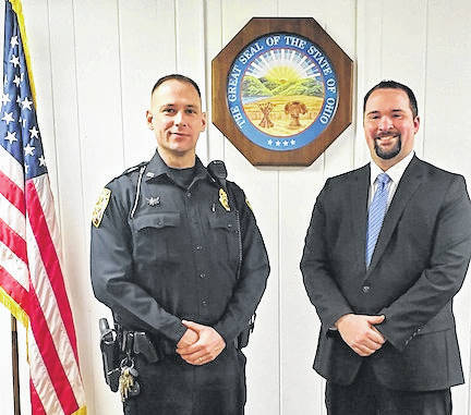 Mount Gilead Police Chief Adam Lakey is shown with Mayor Jamie Brucker. Brucker swore in Lakey to his new position on Feb. 26.
