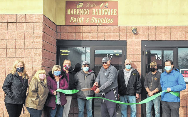 Hinkle's Marengo Hardware paint and supplies store celebrated their opening with a Chamber of Commerce ribbon cutting. From left: Erin Kelty, Carol Weiss, Ronda Siegfried, Tim Siegfried, Enoch Adkins, Wayne Hinkle, Paul Hinkle, Jared Hughes and Joel Smythe.