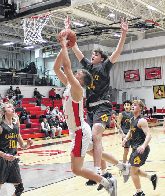 Cardington senior Avery Harper looks for two of his 20 points in his team's district semifinal contest with Berne Union on Tuesday.