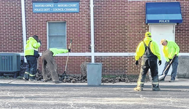 Village of Mount Gilead crews spent part of Monday morning cleaning up around the administration building and police department at 72 W. High St.