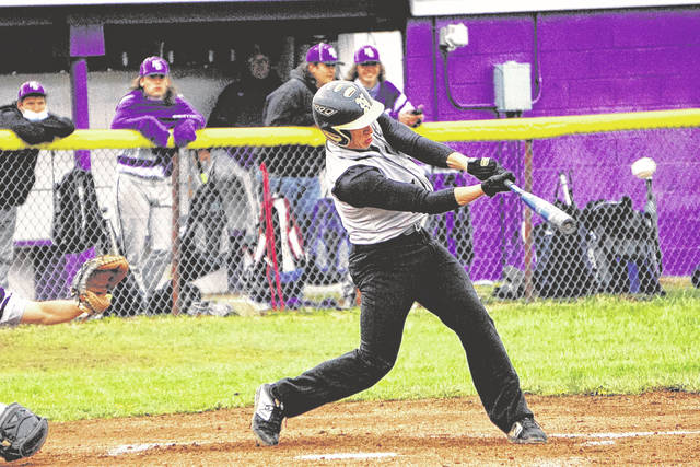 Northmor's Garrett Corwin gets a hit against Mount Gilead on Monday, April 12, 2021, during the completion of a game that was delayed due to rain on Friday, April 9. The Golden Knights earned the win 10-9 and then completed the sweep with a 5-3 victory over the Indians.