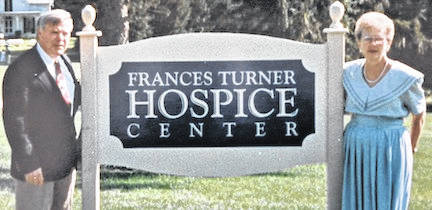 Frances Turner at the first Hospice of Morrow County location on West Marion Road beside Woodside Village Care Center with William Casto who provided the home for Hospice.