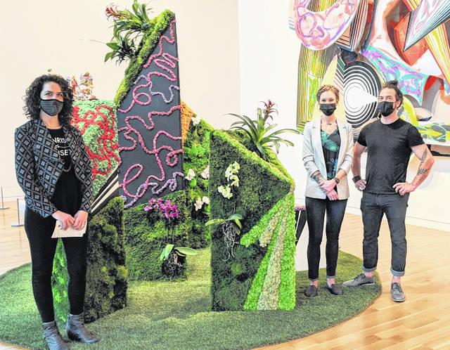 """Planthropy's artwork at the Columbus Museum of Art's """"Art in Bloom."""" From left: Anne Trautman and Planthropy's owners Jessie Laux and Michael Creath. Their exhibit is made with mosses, orchids and succulents."""