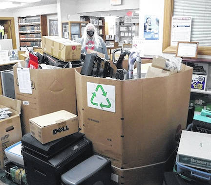 Kelly Kirkpatrick is buried in recycled electronics at the Cardington-Lincoln Public Library.