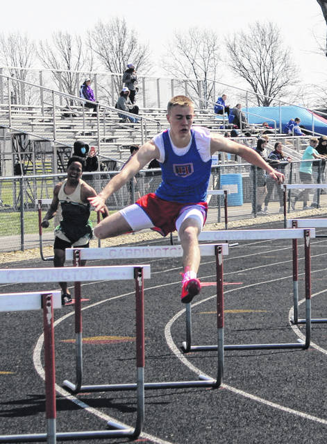 Landon Remmert clears a hurdle on his way to winning the 300-meter hurdles for Highland on Saturday.