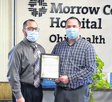 """For the recent National Hospital Week, Morrow County Hospital hosted a number of fun events for associates, while the highlight of the week was a visit from Mayor Jamie Brucker (right) who presented a proclamation, as follows: Whereas National Hospital Week is May 9-15, and the official theme is """"Inspiring Hope Through Healing,"""" and whereas individuals all across the country will be celebrating this time-honored event; And whereas the hard-working people that comprise our hospital deserve universal regard and appreciation for keeping our community healthy; Be it known that on this ninth day of May, I, Jamie Lee Brucker, Mayor of Mount Gilead, do hereby declare May 9-15, 2021, to be Hospital Week in Mount Gilead, Ohio, and urge residents to express their appreciation for Morrow County Hospital, as well as the people, facilities and technologies that make trustworthy, reliable health care possible in our community.""""CJ Miller, president, Morrow County Hospital (left) said, """"We are so grateful for Mayor Brucker's support. It meant a lot to our team for him to take the time to come to the hospital and share such a thoughtful message."""""""