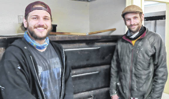 Zac Butterfield, left, and James (Jay) Walsh stand by the pizza ovens at the Purple Indian.