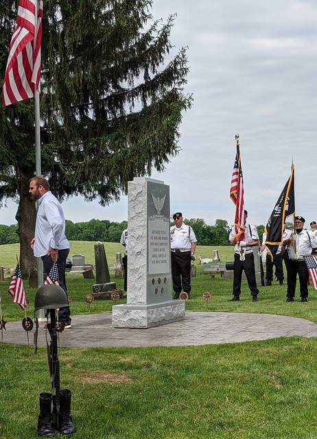 """<p class=""""xmsonormal"""">Veterans place flags at the new Bryn Zion memorial."""