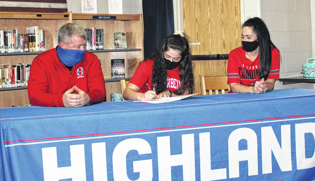 Highland senior Peyton Carpenter signs to run track and field for Otterbein University. Sitting with her are her parents, Chad and Erin.