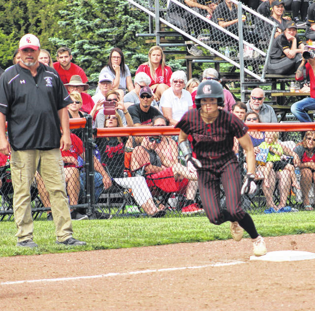 Cardington's Dana Bertke starts heading from third base to home in her team's 4-0 win over Milan Edison in Wednesday's Division III regional semifinal softball game hosted by Elida High School. Bertke led off the game with a triple and was brought home by a Mikayla Linkous hit to stake the Pirates to an early lead.