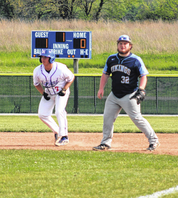 Highland's Dom Carter (l) leads off first base in Thursday's sectional game with River Valley. Carter reached base three times via a hit and a pair of walks to help the Scots earn a 3-1 victory and advance in the postseason.