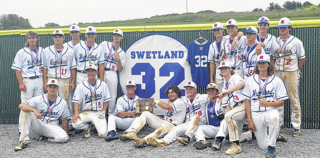 The Highland baseball team poses with their district championship trophy in front of a display commemorating former Scot standout Jett Swetland, who passed away in 2020.