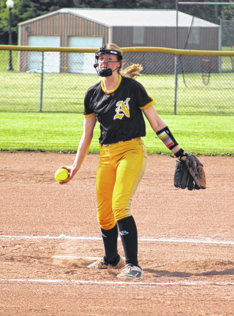 Megan Adkins prepares to unleash a pitch against Fisher Catholic Tuesday. She went the distance in leading Northmor's softball team to the district finals in a 10-4 win over the Irish.