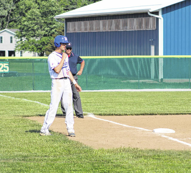 Highland's Rider Minnick stands by third base early in his team's 4-3 win over Bishop Hartley that advanced the Scots to the district finals.