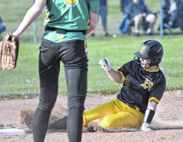 Northmor's Taylor Cantrell slides into base safely in her team's come-from-behind 8-7 sectional softball win over visiting Madison Plains.