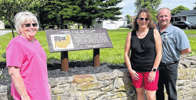 Cardington Mayor Susie Peyton and Troy and Dawn Ruehrmundnwith the newly restored Greenville Treaty plaque placed on the Treaty line on the Ruehrmund property.