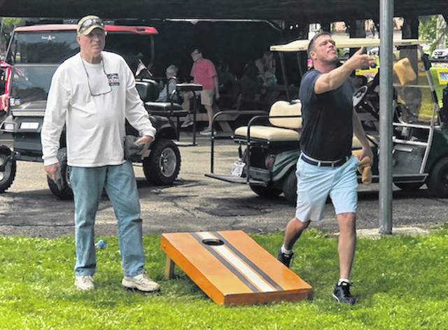 Randy Burns and Mark Spires in the corn hole tournament in 2019. It returns as part of the Cardington Street Fair.