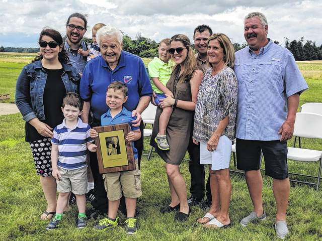 Jack Fishburn with several of his family members and the ODNR Hall of Fame award presented to him in 2018.