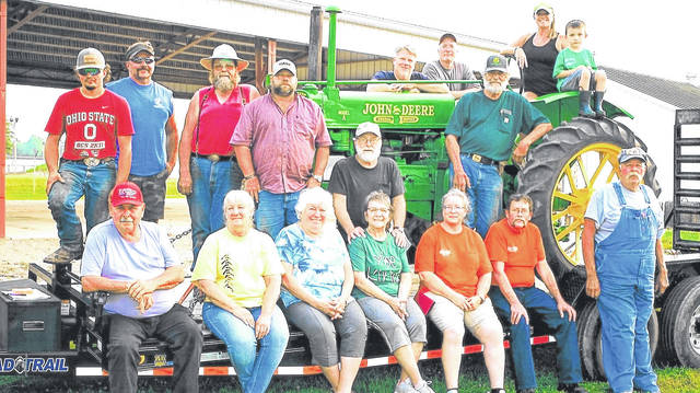 Farm Days officers are, first row, from left: Nick Gerasimof, Deb Osborne, Kathy Gerasimof, Nancy Welch, Nissa Jenkins. Mike Squibb and Dwight Murphy. Middle row: Mason Powell, John Powell, Jon Axthelm, Dave Broadwater, Larry Welch and Jim Carroll. Back row: Joel Seckel, Todd Jenkins, Jodee Seckel Wagner and William Jenkins is the youngster. The group surrounds a 1935 Model A antique John Deere tractor. This tractor was owned by Jeff Seckel, who passed away Feb.16, 2015. Two of his siblings, Jodee Seckel Wagner and Joel Seckel,both pictured, have continued to honor his memory and love for the Morrow County Tractor Association and Farm Days by continuing to keep the tractor running and transporting to events with the help of fellow member, John Powell.