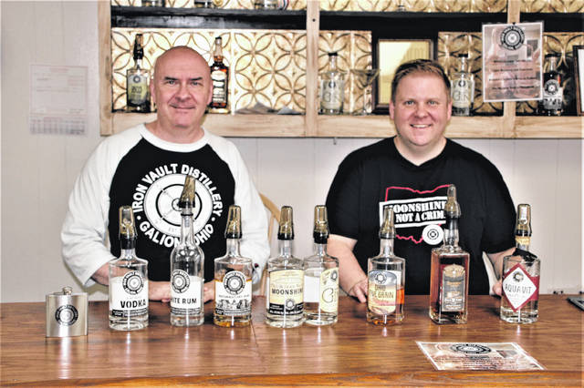 Dad John Bassett, left, and son John Bassett, right, are shown behind the counter at Iron Vault Distillery LLC, 134 Harding Way West in Galion. The ownership team includes the Bassett family and friend Sam Thacker. The Bassetts said business has been steady and good since the distillery was founded in 2017.