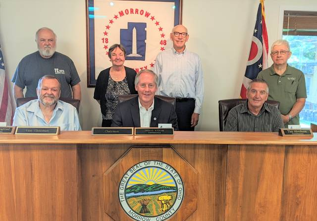 Morrow County Park District Board members in back, from left: Steve Fuller, Dixie Shinnaberry, Bill Loebick and Jim Overmoyer. Cathie Robinson was not present. Commissioners from left: Tim Siegfried, Tom Whiston and Tim Abraham.