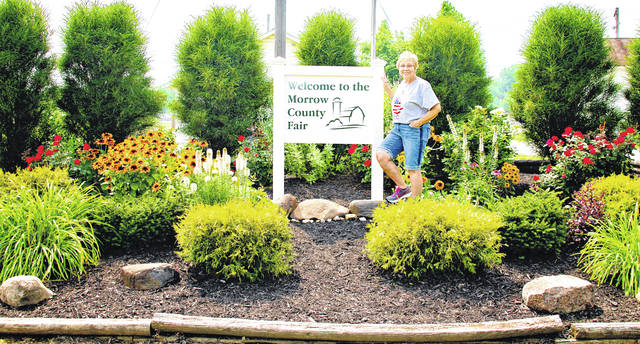 Maggie Clark with her flowers at the entrance to the Morrow County Fairgrounds.