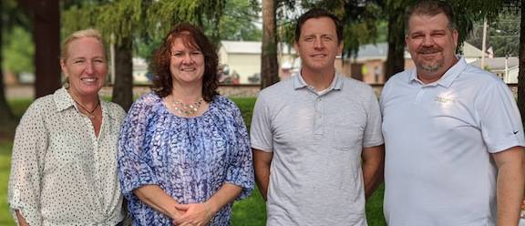Shown from left: Chamber of Commerce Vice President Erin Kelty, Wendi Reichardt of NAMI, outgoing Chamber Director Joel Smythe and Chris Conant of the Chamber board.