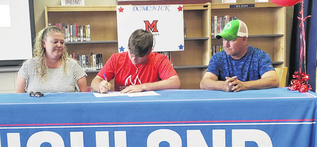 Highland graduate Domonick Carter will play baseball at Miami University Middletown, while majoring in forensic science. He is pictured with parents Jessica and George in the above picture.