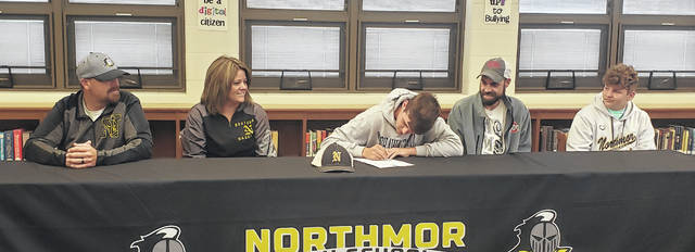 Preston Harbolt, a 2021 Northmor graduate, signs to play baseball for Shawnee State University. Pictured with him are (l-r): stepfather Jim Fischer, mother Brittany Fischer, father Arthur Harbolt and brother Parker Harbolt.